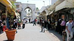 Tangier Daily Walk (cwgoodroe) Tags: ocean africa street old city sea summer people sun fish bus colors metal ferry plane children cafe sand ancient colorful doors artistic pentax vibrant muslim poor streetlife mosque arabic panasonic doorway morocco arab friendly moors conservative script casbah vegtable merchants continent merchant christians tangier monger moroccan tanger kasbah cleric sadfaces metaldoors fishmerchant casba casbha dailylifeportrait