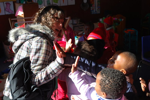 Hi-fives with pre-schoolers at Neoh ECD centre