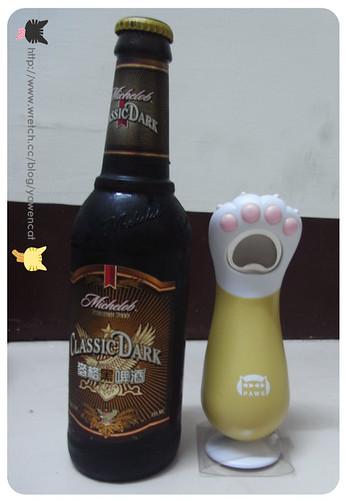 你拍攝的 2009生日禮物~貓腳開瓶器。