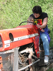 Grandma R and Gavin ride a tractor