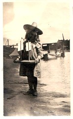 Girl wearing a big hat holding a boat (oldsailro) Tags: ocean park old boy sea summer people sun lake playing beach water pool girl hat sunshine youth sailboat race vintage children fun toy boat miniature wooden big pond model waves sailing ship child time yacht antique group boom mat regatta hull spectators watercraft adolescence keel fashioned