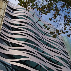 Barcelona, Commercial Building (Detlef Schobert) Tags: barcelona espaa building metal shop retail architecture facade de hotel store spain arquitectura apartments bcn catalonia paseo commercial ito architektur catalunya metall fachada  suites passeig faade catalua spanien gracia fassade toyo toyoito  espanya katalonien passeigdegrcia paseodegracia