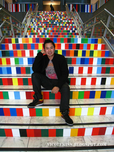 danny posing in art gallery staircase