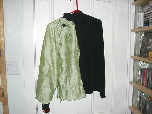 Green half-shirt over black turtleneck