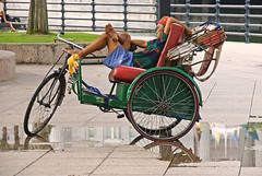 Trishaw driver having a nap (IngeHG) Tags: reflection puddle singapore raw nap walkway manual empressplace trishaw singaporeriver asiancivilisationsmuseum nikond60 289365 trishawdriver goldstaraward 52wau2009 t189project365 fullertonreflection