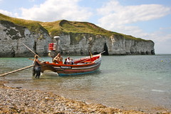 Sail away with me (Charles Frost) Tags: sea sky cliff beach water clouds canon eos coast boat sand stones yorkshire pebbles cave flamborough 40d