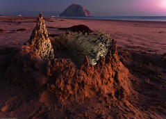 Sandcastle on Morro Strand State Beach, with Morro Rock visible in background, after sunset 24 Aug 2009