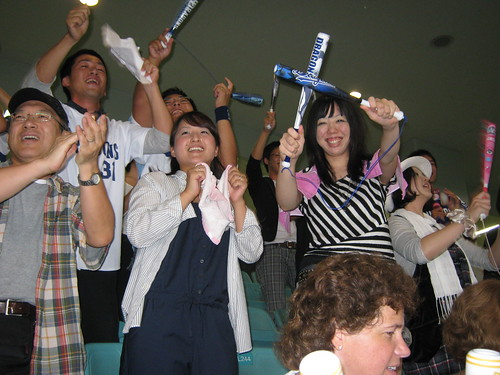 Our favorite group of bankers. Stripes, the aforementioned wife, is the one posing in the photo with her thundersticks.
