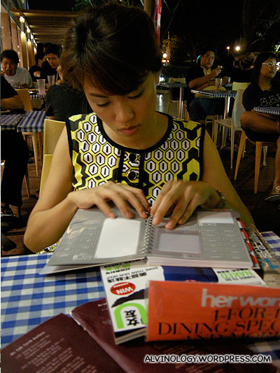 Rachel reading her magazine while I munch on the prata