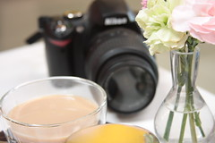 still life with tea, flowers and nikon