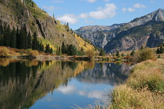 Crystal Pond Fall Reflections (littlelori) Tags: autumn vacation southwest color reflection fall water still colorado day pines aspen ouray crystallake milliondollarhighway hwy550 mirrorlike redmountains wowiekazowie crystalpond pwpartlycloudy