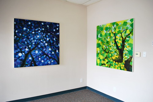 Two new paintings hanging on the wall...