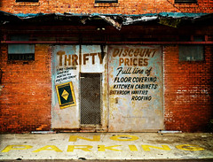 Thrifty Decay (evanleavitt) Tags: county urban color brick sign wall by ga georgia jack evans decay no bare painted parking ghost inspired olympus william chatham walker signage bones faux weathered savannah kodachrome fading advertisment prices typology delano fsa thrifty in e510 christenberry discout nonhdr