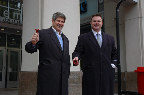Jeff Smulyan and Pat Walsh of Emmis Communications ring bells outside of WIBC.