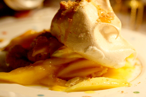 Meringue with salted caramel and mango close