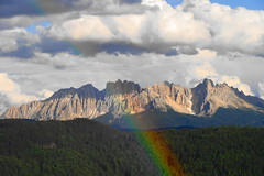 La montagna e l'arcobaleno  - The mountain and the rainbow (Cristina 63) Tags: sky italy mountains clouds montagne rainbow europa europe italia nuvole cielo arcobaleno montagna dolomiti altoadige southtyrol nwn mounts suedtirol latemar dolomities renon ritten oberbozen soprabolzano mariaassunta mariahimmelfahrt holidays2009 vacanze2009