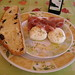 Mozzarella di bufala, prosciutto, black pepper, olive bread and Biancolilla