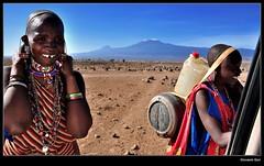 Masai women on Kilimanjaro (Giovanni Gori) Tags: africa trip morning travel wild vacation portrait woman mountain holiday snow kilimanjaro portraits landscape geotagged landscapes nikon women kenya scenic safari viaggio masai vacanza paesaggio amboseli wildness d90 nikkor1224mmf4g flickrlovers giovannigori