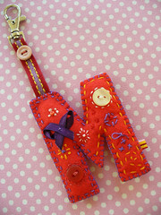 M_1 (designedbynora) Tags: embroidery buttons sewing letters quilting patchwork homespun