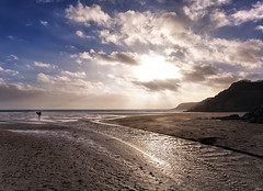 walking back (Laurence Cartwright) Tags: uk sea sun beach wales clouds photo sand surf photograph surfers gowerpeninsula caswellbay flickrdiamond laurencecartwright