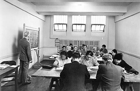 A classroom for immigrants learning to speak English probably at Red Hook Houses community center in Brooklyn, September 24, 1940. Is that Hyman Kaplan at the back of the room?