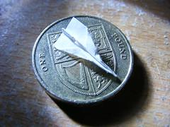 Tiny paper aeroplane. (steven.barker57) Tags: macro plane paper airplane coin little small aeroplane tiny concorde pound smallest 18november2009