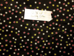 Multi dots on black quilting cotton