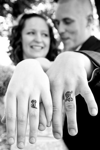 Matt and Sarah got black wedding bands tattooed on their ring fingers.