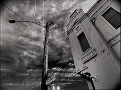 mulcahy's remains (mugley) Tags: blackandwhite bw building 120 film architecture clouds mediumformat wire pub 645 suburban kodak streetlamp decay trix grain australia melbourne cable victoria 400tx scan negative lamppost epson silos suburbs streaks polarizer 6x45 vignetting vignette leaning cloudporn mamiya645 urbanlandscape redfilter northmelbourne victoriast polariser blacksky kodaktrix400 25a v700 cloudage keystoning mamiya645protl m645 35mmf35sekorn mulcahyshotel ad1929