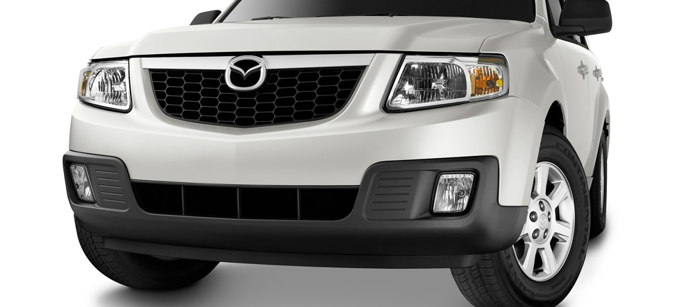 halogen fog lights, front chrome grille Tribute