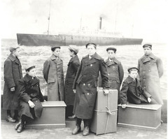 NCH boys leave for Canada (theirhistory) Tags: boy canada hat boat kid ship child boots background coat picture rope case orphanage orphans staff cap wellies childrenshome nationalchildrenshome