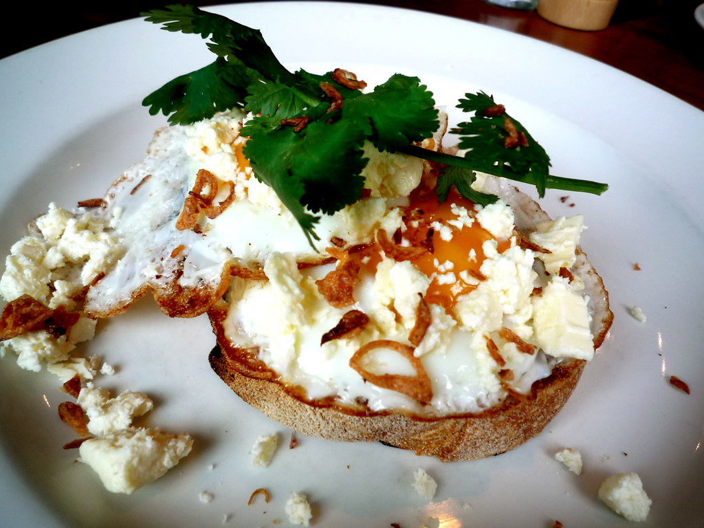 Fried egg bruschetta with fetta and crispy shallots