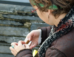 Roll up (farwest56) Tags: uk england woman girl glasses cafe cornwall cigarette coat earring tourists smoking ring stives headband rollup cigarettepaper a350