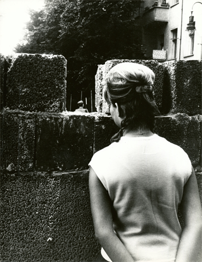 1961_woman looks through wall at guard_sRGB_400w