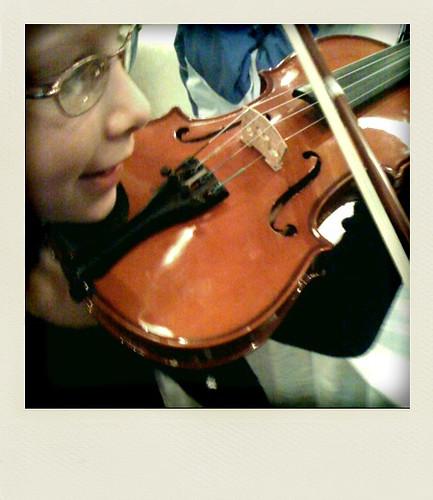Sarah tries out a violin at the NAC