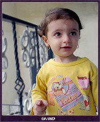 Aysan II آيسان (©I\/IID) Tags: baby eye love look yellow fence hair kid kiss child heart bears fingers earring lips niece curosity aysan appleofmomseye