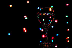 Wine Glass & Christmas Lights (krazyvshank) Tags: christmas glass colors reflections lights nikon wine bokeh 85mm nikkor f18 d300 travelsofhomerodyssey