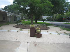 Concrete sidewalk pads and barrel trio