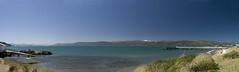 Wellington Harbour Panorama (dmcgphoto) Tags: newzealand sky panorama mountains beach water canon pier 300d sigma playa hills wharf polarizer midday tussock seatoun wellingtonharbour ndgrad skygradient