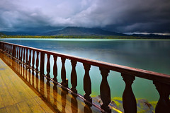 put me in the mood (tropicaLiving - Jessy Eykendorp) Tags: longexposure blue light bali lake storm motion green tourism nature water rain clouds canon fence reflections indonesia landscape photography eos volcano daylight asia southeastasia rail mount exotic crater caldera lee nd filters 1022mm active batur kintamani canon1022mm gnd 50d efs1022mmf3545usm kedisan canoneos50d bigstopper
