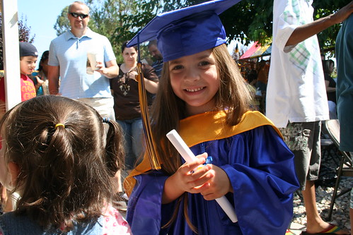 Shaye with her Montessori preschool diploma