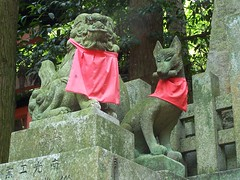 Inari shrine at Fushimi (Kaz_art4sale) Tags: trip travel red dog mountain statue japan stone asian japanese shrine asia rice inari bib lion foo fox shinto foxes deity kitsune fushimi oinari