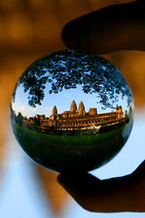 Angkor Wat in glass (kees straver (will be back online soon friends)) Tags: cambodia angkor wat architecture tample crystal ball dof macro reflections explore angkorwat child monk siemreap temple asia orange reflection children sunrise tree monks earthasia sunset travel glass light sphere blue bokeh green refraction crystalball bayon leafs leaf sky hand stairs worldwonder canon eos 30d keesstraver landscape cambodja siem reap