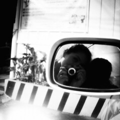 sideview (golfpunkgirl) Tags: bw selfportrait reflection film car 35mm mirror lomo lomography mini baguio sideview testshots golfpunkgirl dianamini