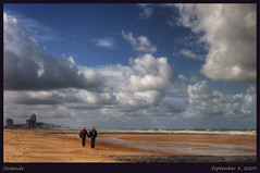 a walk on the beach (Wolfgang Staudt) Tags: sky beach clouds strand pier sand nikon holidays meer stones urlaub tripod sigma northsea promenade hotels oostende nordsee plage ostend kste belgien  westflanders brgge ozean seebad blueribbonwinner nordseekste wolfgangstaudt 66111 touristphotographie nikond300 promenadepier pakhi   moranhanternoz  westvloandern vlamschekust