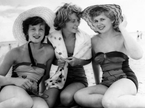 Young women modelling bathers and hats