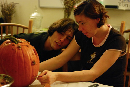 Rachel carving a pumpkin
