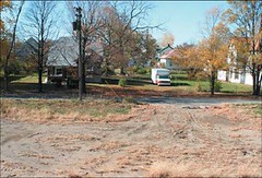 vacant lots with residential street in background (by city of Indianapolis)