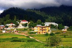 Unpredictable Weather Of Shogran (Amir Mukhtar Mughal | www.amirmukhtar.com) Tags: trees homes pakistan light mountain green weather clouds canon buildings landscape hotel construction colours path scenic hills huts jungle amir hotels kaghan shogran hillstation naran mughal mughals northofpakistan builtuparea northernareaofpakistan amirmukhtar