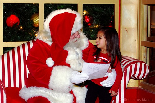 showing Santa her wishlist